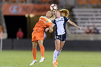 Houston, TX - Saturday July 15, 2017: Rachel Daly and Tori Huster battle for control of a header during a regular season National Women's Soccer League (NWSL) match between the Houston Dash and the Washington Spirit at BBVA Compass Stadium.