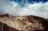 © David Paterson.The Sherpa capital, Namche Bazar, with the 6700m. peak Tamserku appearing above a layer of cloud. Khumbu region, Nepal...Keywords: Sherpa, Namche, Nauche, Bazar, Baazar, Khumbu, Nepal, Himalaya, capital, village, township, settlement, mountain, peak, summit, remote