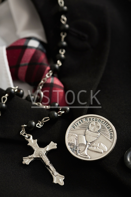 Rosary bead, silver badge with Christian symbols, formal clothes
