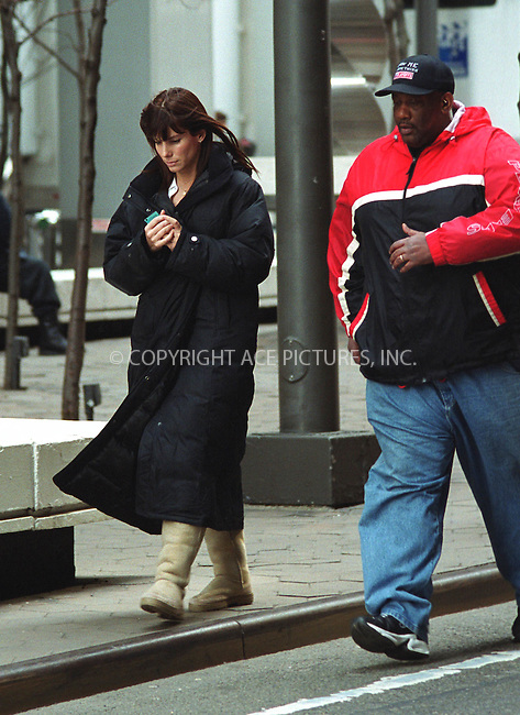 SANDRA BULLOCK takes a break from filming in Downtown Manhattan her new yet untitled movie which is directed by Marc Lawrence. March 7, 2002. © 2002 by Alecsey Boldeskul/NY Photo Press.   ..*PAY-PER-USE*      ....NY Photo Press:  ..phone (646) 267-6913;   ..e-mail: info@nyphotopress.com