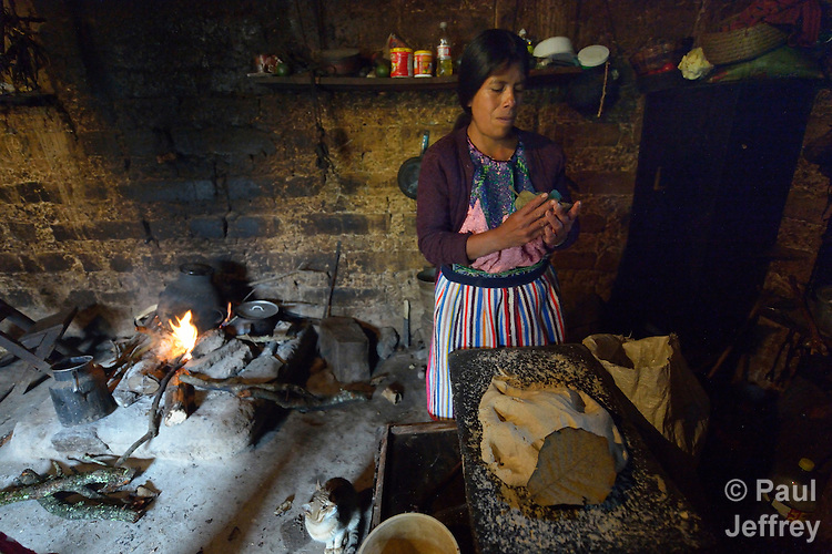 Audelina Vasquez Lopez, a Maya Mam woman, cooks in her home in Tuixcajchis, a small village in Comitancillo, Guatemala.