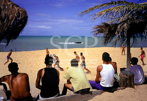 Santa Cruz de Cabralia, Brazil. Young men playing football on the beach.