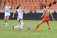 Houston, TX - Saturday July 08, 2017: Celeste Boureille attempts to dribble the ball around Cami Privett during a regular season National Women's Soccer League (NWSL) match between the Houston Dash and the Portland Thorns FC at BBVA Compass Stadium.