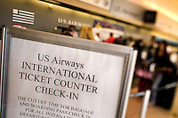 A sign informs travelers at Charlotte-Douglas International Airport. ..Charlotte-Douglas International Airport, one of US Airways' largest hubs, serves 10 major airlines, including Air Canada, Air Tran, American, Continental, Delta, JetBlue, Lufthansa, Northwest and United. The airport is the nation?s 10th largest in terms of total operations, the 18th largest in terms of total passengers and the 37th largest in terms of cargo. Charlotte-Douglas serves 640 daily flights, including direct flights to 120 cities. ..Photographer has series of images from Charlotte-Douglas International Airport, including aerials. ... PATRICK SCHNEIDER PHOTO.COM