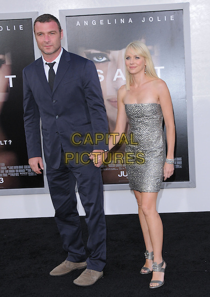 LIEV SCHREIBER & NAOMI WATTS.Premiere of SALT held at The Grauman's Chinese Theatre in Hollywood, California, USA. .July 19th, 2010         .full length strapless silver dress black suit brown shoes holding hands couple open toe sandals grey .CAP/RKE/DVS.©DVS/RockinExposures/Capital Pictures.