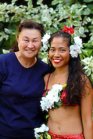 Hapa-Haole hula dancer and Kumu (teacher) outside  the Royal Hawaiian Hotel before the annual festival
