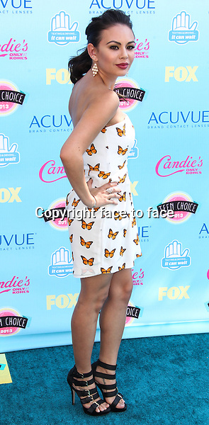 UNIVERSAL CITY, CA - AUGUST 11: Janel Parrish arrives at the 2013 Teen Choice Awards held at Gibson Amphitheatre on August 11, 2013 in Universal City, California. <br />