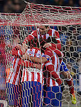 Atletico Madrid's Uruguayan defender Diego Godin celebrates with teammates after scoring during the Spanish Copa del Rey (King's Cup) football match Atletico de Madrid vs Athletic de Bilbao at the Vicente Calderon stadium in Madrid on January 23, 2014.   PHOTOCALL3000/ DP