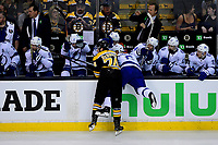 May 2, 2018: Boston Bruins left wing Jake DeBrusk (74) checks Tampa Bay Lightning defenseman Anton Stralman (6) into the Tampa bench during game three of the second round of the National Hockey League's Eastern Conference Stanley Cup playoffs between the Tampa Bay Lightning and the Boston Bruins held at TD Garden, in Boston, Mass. Tampa Bay defeats Boston 4-1. Eric Canha/CSM