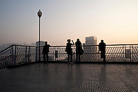 Evening Landscape View Of Tourists Taking Photos Of The Chongqing Cityscape In Chongqing, China.  © LAN