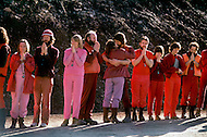 Wasco, Oregon, January 1984: Disciples of Bhagwan Rajneesh, wait in line along the roads of Rajneeshpuram to greet him during  his daily trip through the community in his Rolls-Roys. Rajneeshpuram, was an intentional community in Wasco County, Oregon, briefly incorporated as a city in the 1980s, which was populated with followers of the spiritual teacher Osho, then known as Bhagwan Shree Rajneesh. The community was developed by turning a ranch from an empty rural property into a city complete with typical urban infrastructure, with population of about 7000 followers.