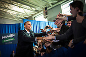 United States President Barack Obama arrives to deliver remarks at a Terry McAuliffe campaign event at Washington-Lee High School, Arlington, Virginia, U.S., on Sunday, November 3, 2013. McAuliffe is the Democratic nominee in the 2013 Virginia gubernatorial election. <br /> Credit: Pete Marovich / Pool via CNP