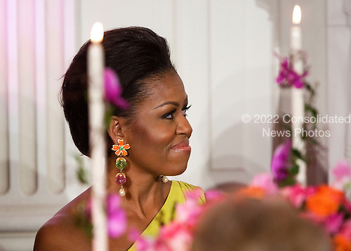 First Lady Michelle Obama listens as U.S. President Barack Obama makes a toast at the start 2011 Governors Dinner at the White House in Washington, D.C., U.S., on Sunday, February 27, 2011..Credit: Joshua Roberts / Pool via CNP