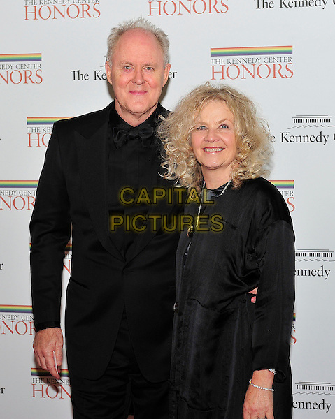 John Lithgow and Dr. Mary Yeager Lithgow.Arriving for the formal Artist's Dinner honoring the recipients of the 2011 Kennedy Center Honors at the U.S. Department of State in Washington, D.C., USA,  3rd December 2011..half length black suit tuxedo bow tie .CAP/ADM/RS.©Ron Sachs/CNP/AdMedia/Capital Pictures ..