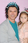 """BURBANK, CA - NOVEMBER 10: Lou Diamond Phillips and daughter arrive at the Disney Channel's Premiere Party For """"Sofia The First: Once Upon A Princess"""" at the Walt Disney Studios on November 10, 2012 in Burbank, California."""