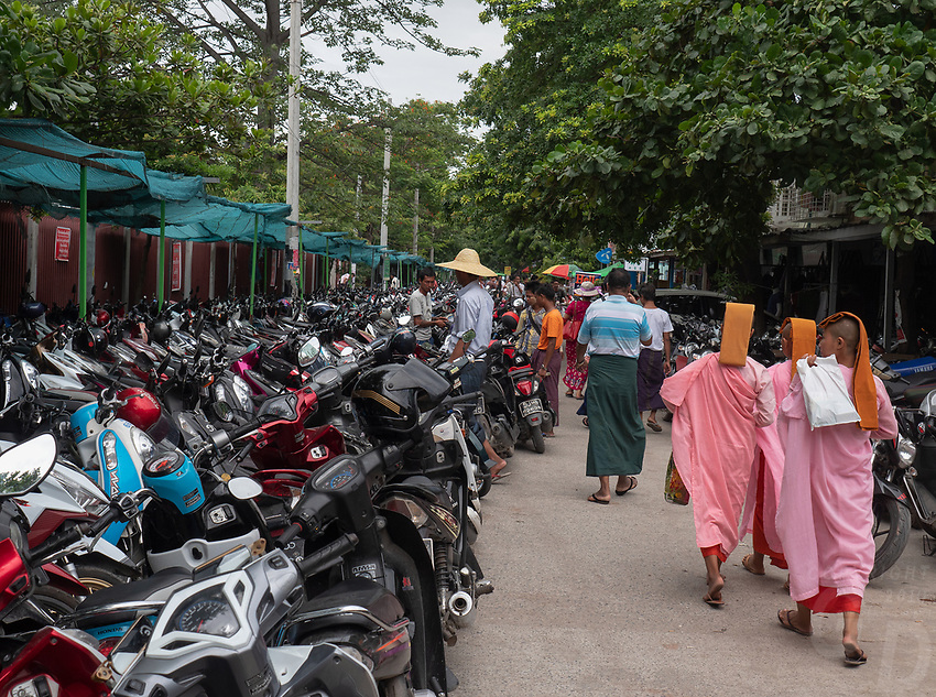Buddhist Nuns walking outside the the Jade Market in Mandalay, Myanmar, Burma
