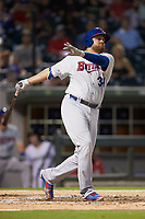 Rowdy Tellez (34) of the Buffalo Bison follows through on his swing against the Charlotte Knights at BB&T BallPark on August 14, 2018 in Charlotte, North Carolina. The Bison defeated the Knights 14-5.  (Brian Westerholt/Four Seam Images)