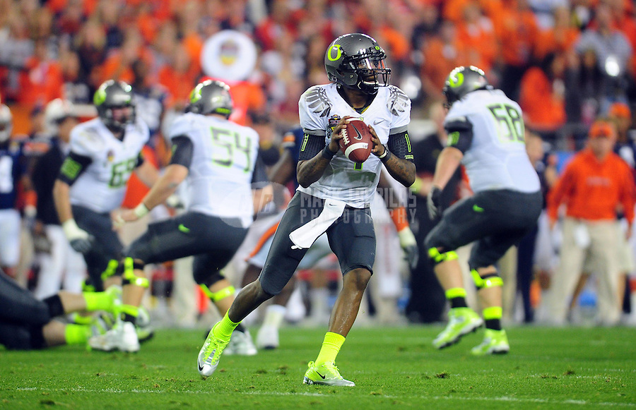 Jan 10, 2011; Glendale, AZ, USA; Oregon Ducks quarterback Darron Thomas (1) throws a pass during the first half of the 2011 BCS National Championship game against the Auburn Tigers at University of Phoenix Stadium.  Mandatory Credit: Mark J. Rebilas-