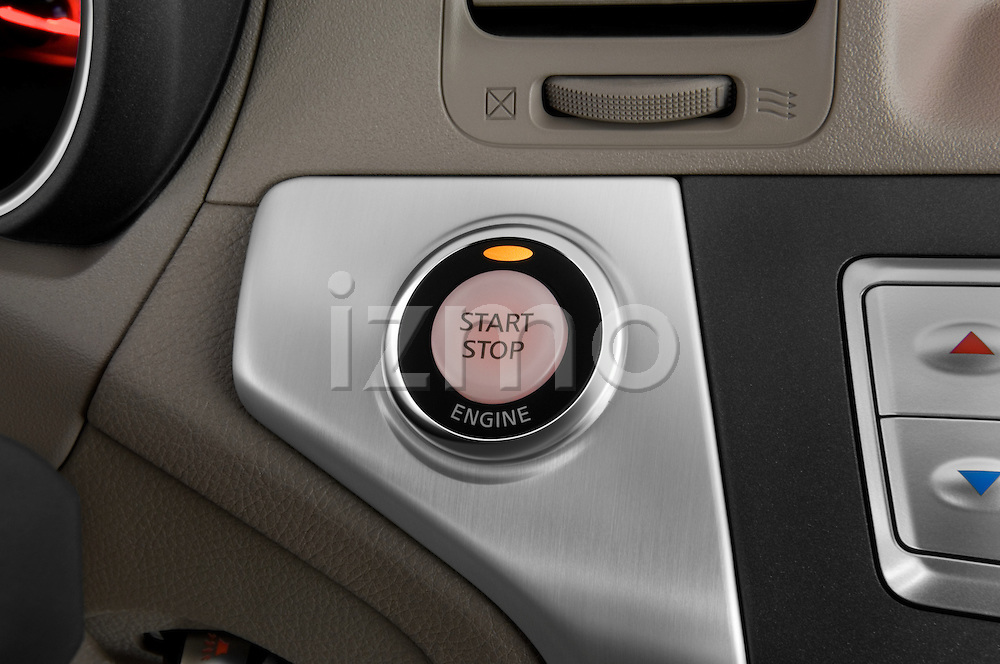 Close up deatil of push button keyless vehivle ignition button on a 2009 Nissan Murano