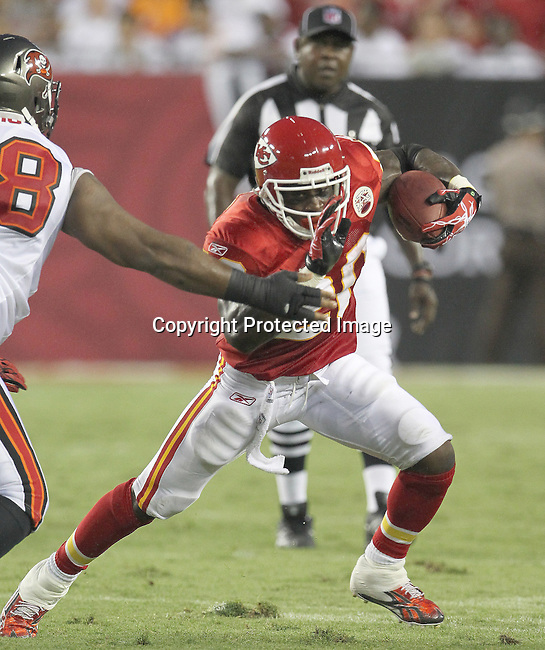 Kansas City Chief's running back Thomas Jones escapes a tackle against the Tampa Bay Buccaneers. The Buccaneers defeated the Chiefs 20-15 during an NFL preseason game Saturday, Aug. 21, 2010 in Tampa,Fla. (AP Photo/Margaret Bowles).