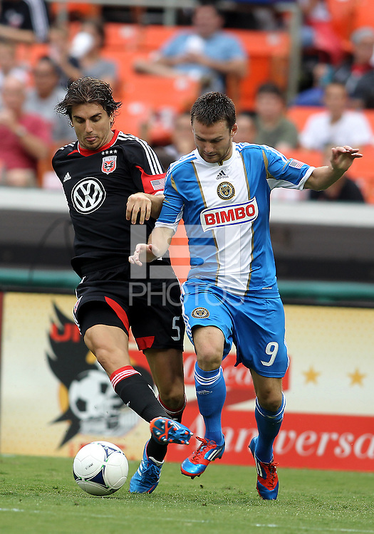 WASHINGTON, D.C. - AUGUST 19, 2012:  Dejan Jakovic (5) of DC United slides the ball away from Jack McInerney (9) of the Philadelphia Union during an MLS match at RFK Stadium, in Washington DC, on August 19. The game ended in a 1-1 tie.