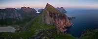 Summertime; Summer; Europe; Lofoten; Lofoten Islands; Lofotens; Nordland; Northern Europe; Norway; Norwegian; Scandinavia; Moskenesoy; Moskenesoya; Moskenesøy; Moskenes; Cliff; Cliffs; Coast; Coastal; Coastline; Hillside; Landscape; Landscapes; Mountain; Mountain Peak; Mountains; Nature; Nobody; Ocean; Outdoors; Outside; Peak; Peaks; Rugged; Remote; Ridge; Scenic; Scenics; Sea; Sky; Steep; Twilight; Sunset; Wild; Arctic Circle; Lofotodden; Lofotodden National Park; National Park; North Atlantic; Norwegian Sea; Yttersia