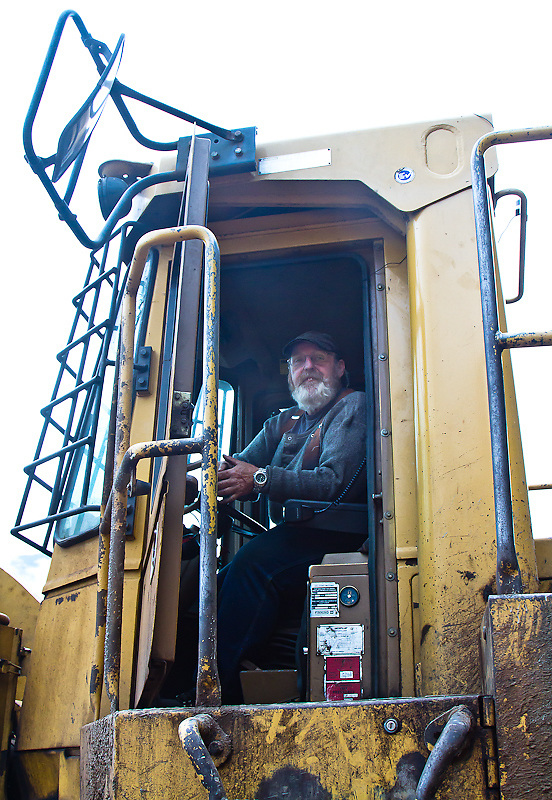 Tim McCormick looks out from the cab of his front end loader at the dryland sort in Knight Inlet, July 2012.