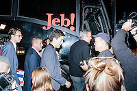 Republican presidential candidate and former Florida governor Jeb Bush greets people after speaking to a crowd in the barn of Dr. and Mrs. James Betti in Rye, New Hampshire, for former Massachusetts senator Scott Brown's No B.S. BBQ series.