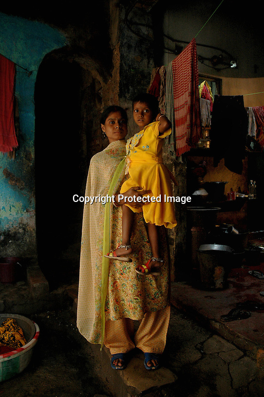 INDIA (West Bengal - Calcutta) -A sex worker(She doesnot wants to disclose her name) and her child both HIV positive (both affected for last 5 years) at their room in Saheb bagan red light area. She is still an active sex worker. - Arindam Mukherjee
