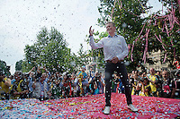 Astana Team Manager Alexander Vinokourov getting champaign showered by the Astana Team celebrating the Overall Team Classifications win on the podium<br /> <br /> Giro d'Italia 2015<br /> final stage 21: Torino - Milano (178km)
