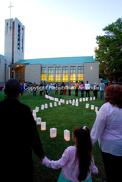 WATERBURY, CT- MAY 16 2010-051610JS04-Supporters gathered outside First Congregational Church in Waterbury on Sunday for a candlelight vigil to remember and give hope to victims of AIDS during the 27th International AIDS candlelight memorial. The event was organized by area faith community and AIDS Ministries. Also on hand were the City of Waterbury Health Department which provided testing and information, New Opportunities and the AIDS/HIV Assistance Program and a dance number by members of the Waterbury Baptist Ministries dance team. <br /> Jim Shannon Republican-American