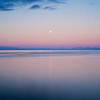 Moonrise over Vestfjord in summer twilight light, Stamsund, Lofoten islands, Norway