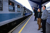 Sarajevo, Bosnia and Herzegovina. People standing on the platform waving goodbye; train on a Sarajevo - Zagreb route.