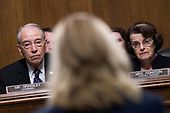 UNITED STATES - SEPTEMBER 27: Chairman Charles Grassley, R-Iowa, and ranking member Sen. Dianne Feinstein, D-Calif., listen to Dr. Christine Blasey Ford during the Senate Judiciary Committee hearing on the nomination of Brett M. Kavanaugh to be an associate justice of the Supreme Court of the United States, focusing on allegations of sexual assault by Kavanaugh against Christine Blasey Ford in the early 1980s. (Photo By Tom Williams/CQ Roll Call/POOL)