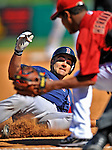 11 March 2011: Boston Red Sox catcher Mark Wagner slides safely into third with a triple during a Spring Training game against the Houston Astros at Osceola County Stadium in Kissimmee, Florida. The Red Sox defeated the Astros 9-3 in Grapefruit League action. Mandatory Credit: Ed Wolfstein Photo