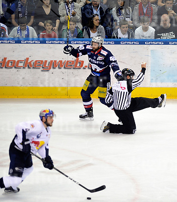 March 31-17,Mercedes-Benz-Arena,Berlin,Germany<br /> DEL Ice-Hockey ,German ice-hockey<br /> Playoff game number 4<br /> Eisbaeren Berlin vs EHC M&Uuml;NCHEN<br /> A referee falls down on the ice after been touched by Berlin`s Darin Olver