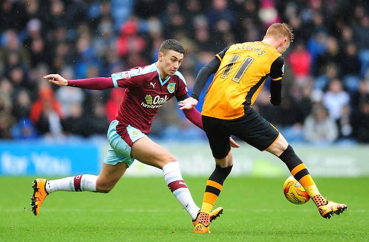 Hull City's Sam Clucas under pressure from Burnley's Matthew Lowton<br /> <br /> Photographer Chris Vaughan/CameraSport<br /> <br /> Football - The Football League Sky Bet Championship - Burnley v Hull City - Saturday 6th February 2016 - Turf Moor - Burnley <br /> <br /> &copy; CameraSport - 43 Linden Ave. Countesthorpe. Leicester. England. LE8 5PG - Tel: +44 (0) 116 277 4147 - admin@camerasport.com - www.camerasport.com