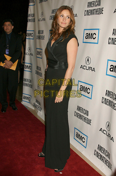 JULIA ROBERTS.The 22nd American Cinematheque Award Ceremony honoring Julia Roberts held at the Beverly Hilton Hotel, Beverly Hills, California, USA,.12 October, 2007..full length black dress.CAP/ADM/RE.©Russ Elliot/AdMedia/Capital Pictures.