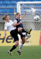 USA's Whitney Engen fights for the ball with Germany's Alexandra Popp during their Algarve Women's Cup soccer match at Algarve stadium in Faro, March 13, 2013.  .