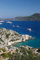 Turkey, Province Antalya, Ucagiz, near Kas: Rocky coastline looking to island Kekova | Tuerkei, Provinz Antalya, Uecagiz, bei Kas: felsige Kueste und Blick zur Insel Kekova
