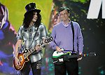 Guitarist Slash, left, plays next to Microsoft chairman Bill Gates, right, during his keynote address at the Consumer Electronics Show (CES) in Las Vegas, Sunday, Jan. 6, 2008 . (AP Photo/Paul Sakuma)
