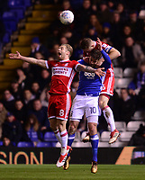 Adam Clayton of Middlesbrough Lukas Jutkiewicz of Birmingham and Ben Gibson of Middlesbrough battle for a header during the Sky Bet Championship match between Birmingham City and Middlesbrough at St Andrews, Birmingham, England on 6 March 2018. Photo by Bradley Collyer / PRiME Media Images.