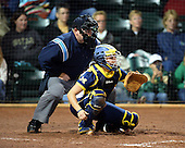Umpire Kevin Jack and Michigan Wolverines Softball catcher Lauren Sweet (25) during a game against the University of South Florida Bulls on February 8, 2014 at the USF Softball Stadium in Tampa, Florida.  Michigan defeated USF 3-2.  (Copyright Mike Janes Photography)