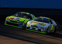 Nov 13, 2005; Phoenix, Ariz, USA;  Nascar Nextel Cup driver Kyle Busch driver of the #5 Kellogs Chevy battles with Greg Biffle #16 for the lead at the Checker Auto Parts 500 at Phoenix International Raceway. Mandatory Credit: Photo By Mark J. Rebilas