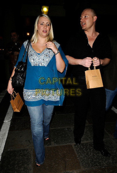 "CLAIRE RICHARDS & GUEST.The ""Never Forget"" gala night afterparty, 1 The piazza, Covent garden, London, England..May 22nd, 2008.after party full length black blue top kaftan goody bag jeans denim ex-steps .CAP/CAN.©Can Nguyen/Capital Pictures."