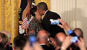 United States President Barack Obama kisses Mayor Stephanie C. Rawlings-Blake (Democrat of Baltimore, MD) after her introduction at a reception for the nation's mayors in the East Room of the White House in Washington, DC on January 21, 2016.<br /> Credit: Dennis Brack / Pool via CNP