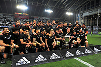 The All Blacks pose with the Bledisloe Cup after winning the Rugby Championship and Bledisloe Cup rugby match between the New Zealand All Blacks and Australia Wallabies at Forsyth Barr Stadium in Dunedin, New Zealand on Saturday, 26 August 2017. Photo: Dave Lintott / lintottphoto.co.nz
