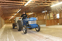 NWA Democrat-Gazette/FLIP PUTTHOFF<br />LIGHTS UP FOR FAIR<br />Chuck Mason spreads water on Wednesday Oct. 11 2017 over the the gravel floor of a War Eagle Fair crafts building to keep the dust down. Workers were busy Wednesday installing lights in tents and doing other chores to get ready for the annual fair. War Eagle and other arts and crafts fairs start next week. War Eagle Fair dates are Oct. 19-22. The fair was founded in 1954 on the banks of the War Eagle River.