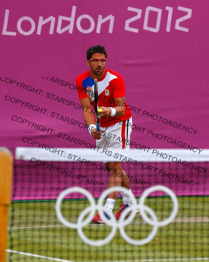 Olympic games London 2012.Tennis tournament.Janko Tipsarevic and Nenad Zimonjic SRB v Klizan and Lacko SVK.Janko Tipsarevic  in action.London, 30.07.2012..foto: Srdjan Stevanovic/Starsportphoto ©