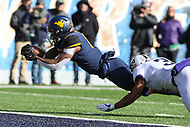 Morgantown, WV - November 10, 2018: West Virginia Mountaineers running back Kennedy McKoy (6) dives for a touchdown during the game between TCU and WVU at  Mountaineer Field at Milan Puskar Stadium in Morgantown, WV.  (Photo by Elliott Brown/Media Images International)